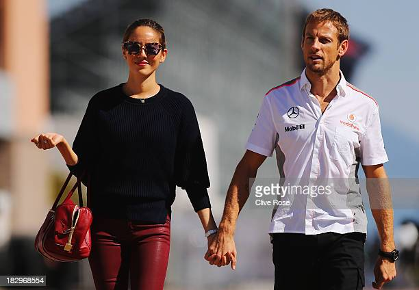 Jenson Button of Great Britain and McLaren and his girlfriend Jessica Michibata arrive in the paddock during previews for the Korean Formula One...