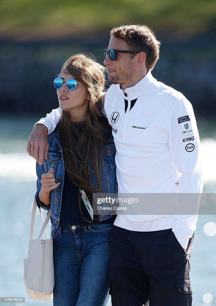 Jenson Button of Great Britain and McLaren and Jessica Michibata arrive at the circuit prior to final practice for the Canadian Formula One Grand Prix at Circuit Gilles Villeneuve on June 6, 2015 in Montreal, Canada.