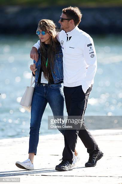 Jenson Button of Great Britain and McLaren and Jessica Michibata arrive at the circuit prior to final practice for the Canadian Formula One Grand...