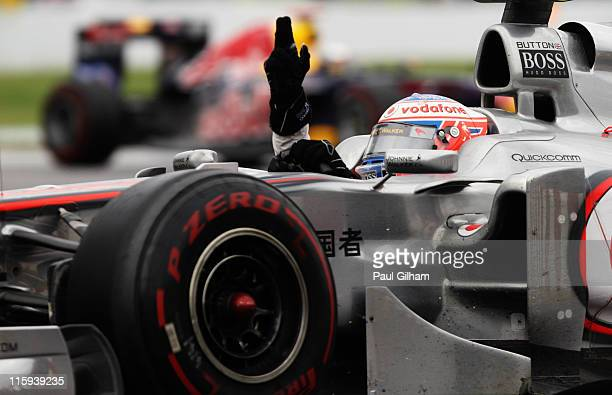 Jenson Button of Great Britain and McLaren celebrates after winning the Canadian Formula One Grand Prix at the Circuit Gilles Villeneuve on June 12,...