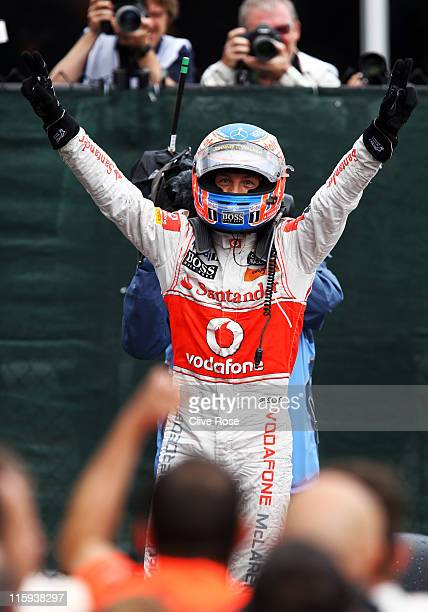 Jenson Button of Great Britain and McLaren celebrates in parc ferme after winning the Canadian Formula One Grand Prix at the Circuit Gilles...