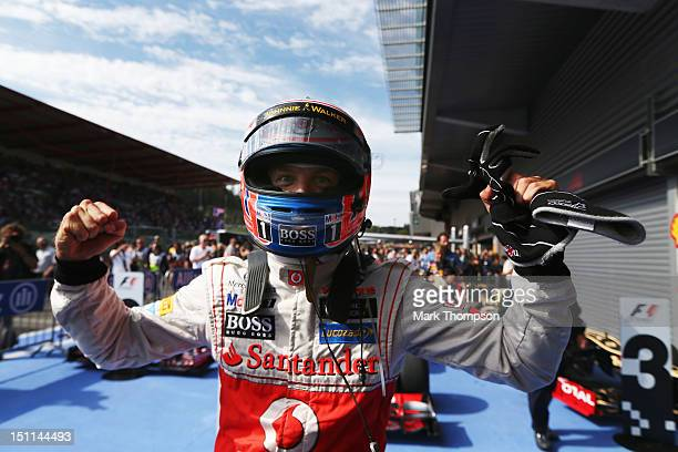 Jenson Button of Great Britain and McLaren celebrates in parc ferme after winning the Belgian Grand Prix at the Circuit of Spa Francorchamps on...