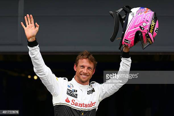 Jenson Button of Great Britain and McLaren celebrates in Parc Ferme after claiming third place on the grid during qualifying ahead of the British...