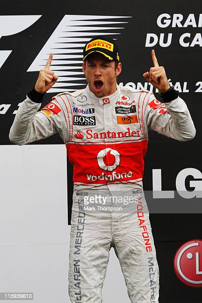 Jenson Button of Great Britain and McLaren celebrates on the podium after winning the Canadian Formula One Grand Prix at the Circuit Gilles...
