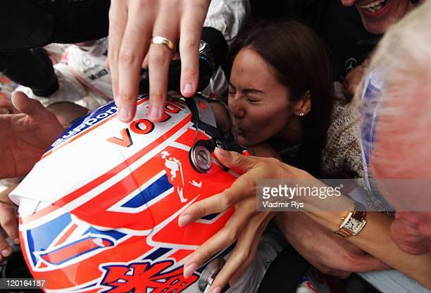 Jenson Button of Great Britain and McLaren celebrates winning his 200th Grand Prix with his girlfiend Jessica Michibata and his father John Button...