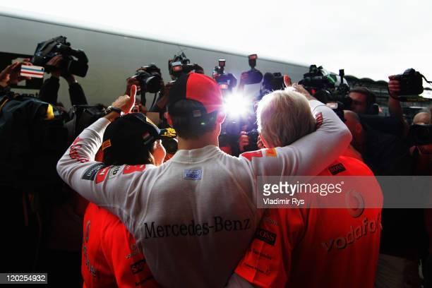 Jenson Button of Great Britain and McLaren celebrates winning his 200th Grand Prix with his girlfiend Jessica Michibata his father John Button...