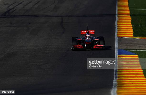 Jenson Button of Great Britain and McLaren drives down the pit lane during winter testing at the Ricardo Tormo Circuit on February 3, 2010 in...