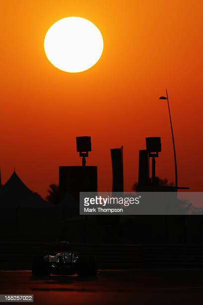 Jenson Button of Great Britain and McLaren drives during practice for the Abu Dhabi Formula One Grand Prix at the Yas Marina Circuit on November 2,...