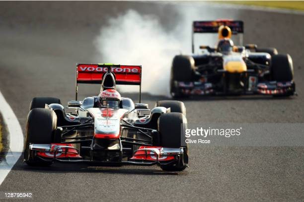 Jenson Button of Great Britain and McLaren drives on his way to winning the Japanese Formula One Grand Prix at Suzuka Circuit on October 9 2011 in...