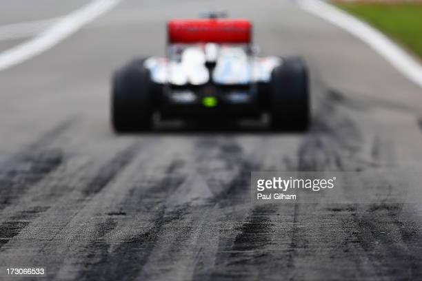 Jenson Button of Great Britain and McLaren exits the pitlane to drive during the final practice session prior to qualifying for the German Grand Prix...