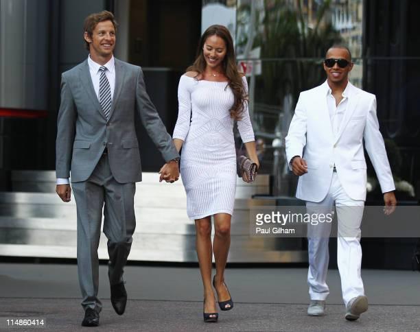 Jenson Button of Great Britain and McLaren his girlfriend Jessica Michibata and Lewis Hamilton of Great Britain and McLaren leave the paddock for the...