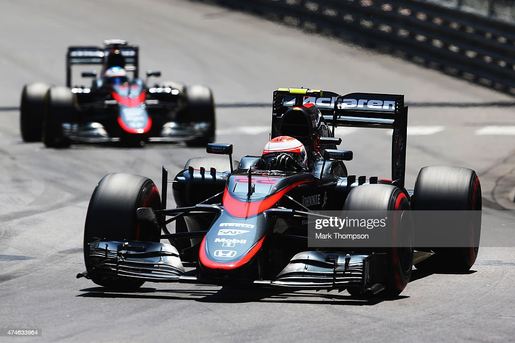 Jenson Button of Great Britain and McLaren Honda leads from team mate Fernando Alonso of Spain and McLaren Honda on his way to scoring the first points for his team during the Monaco Formula One Grand Prix at Circuit de Monaco on May 24, 2015 in Monte-Carlo, Monaco.