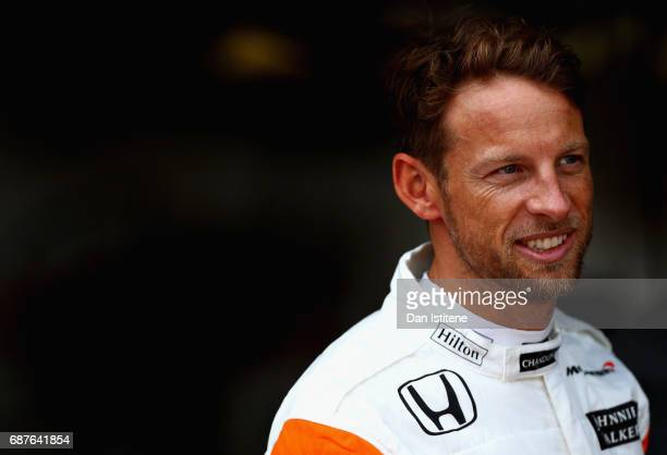 Jenson Button of Great Britain and McLaren Honda prepares for a seat fitting in the garage during previews for the Monaco Formula One Grand Prix at...