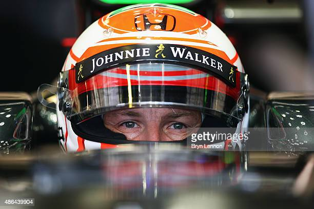 Jenson Button of Great Britain and McLaren Honda sits in his car in the garage during practice for the Formula One Grand Prix of Italy at Autodromo...
