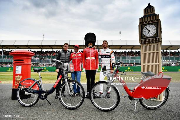 Jenson Button of Great Britain and McLaren Honda Stoffel Vandoorne of Belgium and McLaren Honda and Marc Gene pose for a photo during the Santander...