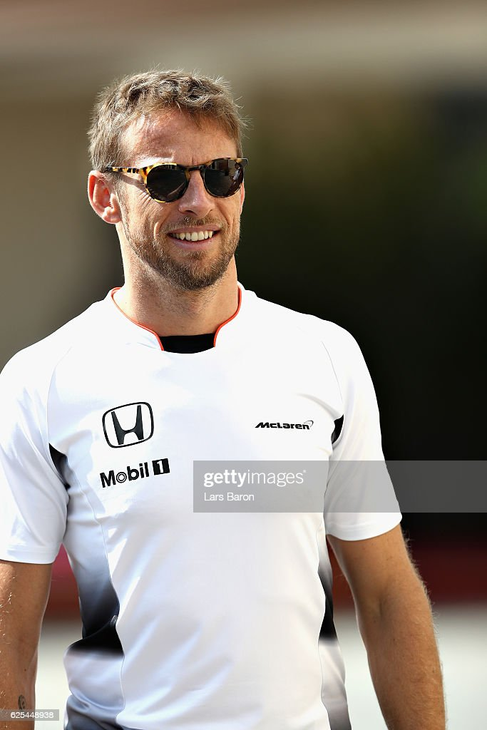 Jenson Button of Great Britain and McLaren Honda walks in the Paddock during previews for the Abu Dhabi Formula One Grand Prix at Yas Marina Circuit on November 24, 2016 in Abu Dhabi, United Arab Emirates.