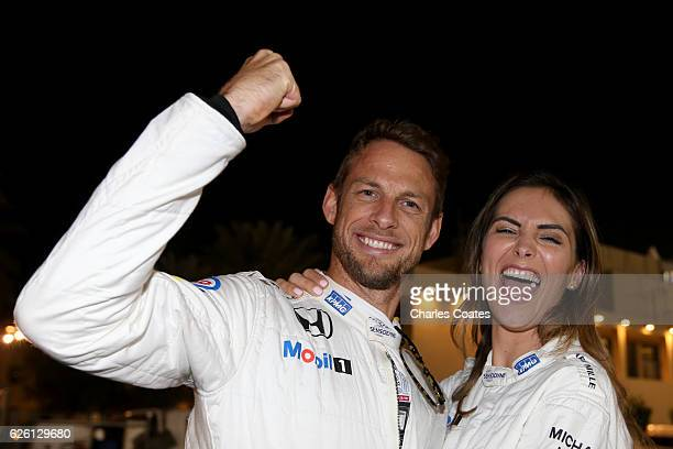 Jenson Button of Great Britain and McLaren Honda with girlfriend Brittny Ward leaving the paddock together after Jenson's final F1 race during the...