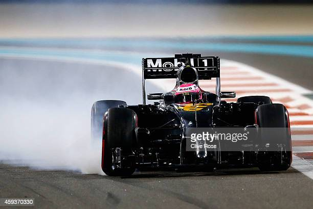 Jenson Button of Great Britain and McLaren locks up during practice ahead of the Abu Dhabi Formula One Grand Prix at Yas Marina Circuit on November...