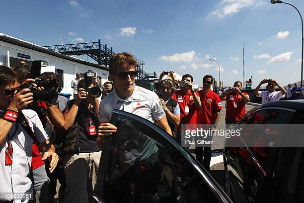 Jenson Button of Great Britain and McLaren Mercedes arrives at the F1 paddock before the Brazilian Formula One Grand Prix at the Interlagos Circuit...