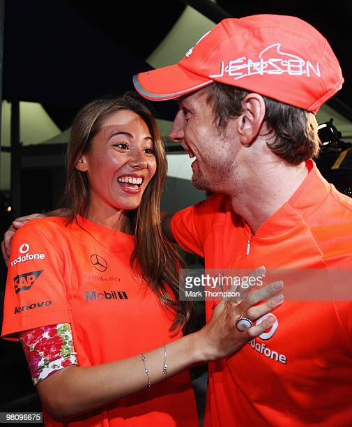 Jenson Button of Great Britain and McLaren Mercedes celebrates with girlfriend Jessica Michibata in the paddock after winning the the Australian...