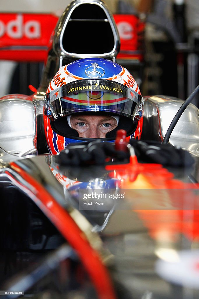 eb6c3bad17a Jenson Button of Great Britain and McLaren Mercedes is seen in his ...