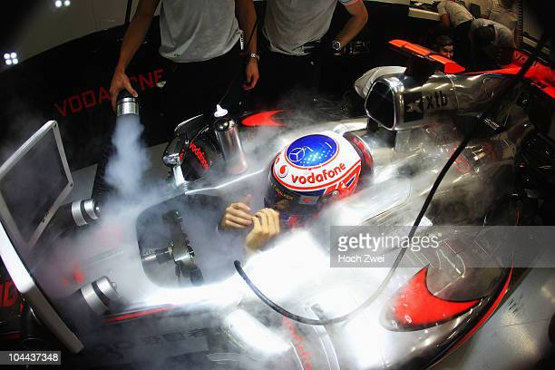 Jenson Button of Great Britain and McLaren Mercedes prepares to drive during practice for the Singapore Formula One Grand Prix at the Marina Bay...