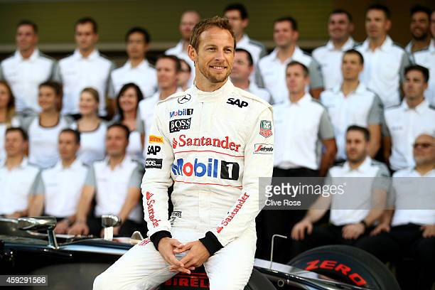 Jenson Button of Great Britain and McLaren poses for a team photograph during previews ahead of the Abu Dhabi Formula One Grand Prix at Yas Marina...