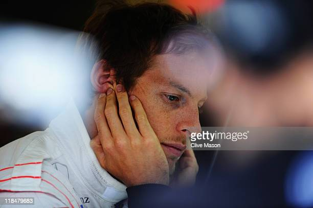 Jenson Button of Great Britain and McLaren prepares to drive during practice for the British Formula One Grand Prix at the Silverstone Circuit on...