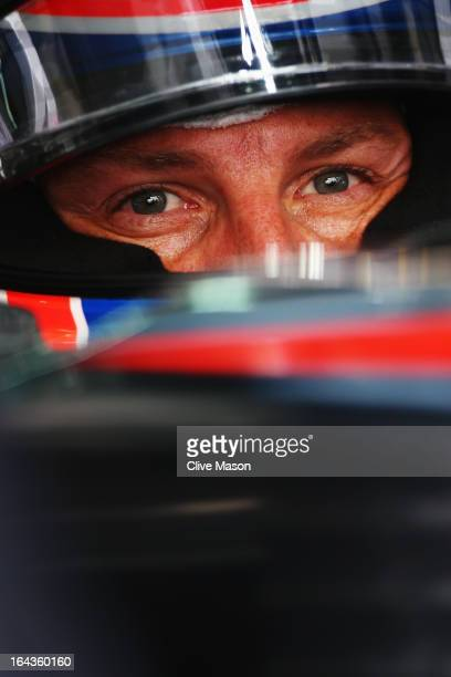 Jenson Button of Great Britain and McLaren prepares to drive during the final practice session prior to qualifying for the Malaysian Formula One...