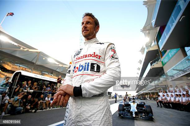 Jenson Button of Great Britain and McLaren prepares to take his place for a team photograph during previews ahead of the Abu Dhabi Formula One Grand...
