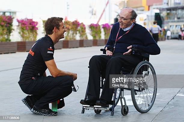 Jenson Button of Great Britain and McLaren talks with Sir Frank Williams in the paddock during previews to the European Formula One Grand Prix at the...