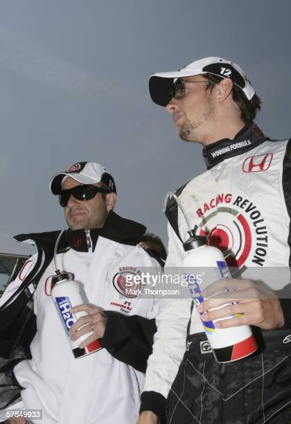 Jenson Button of Great Britain and Rubens Barrichello of Brazil and Honda Racing prior to the European F1 Grand Prix at the Nurburgring on May 7 in...