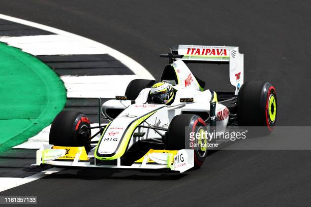 Jenson Button of Great Britain drives his Brawn BGP 001 on track during previews ahead of the F1 Grand Prix of Great Britain at Silverstone on July...