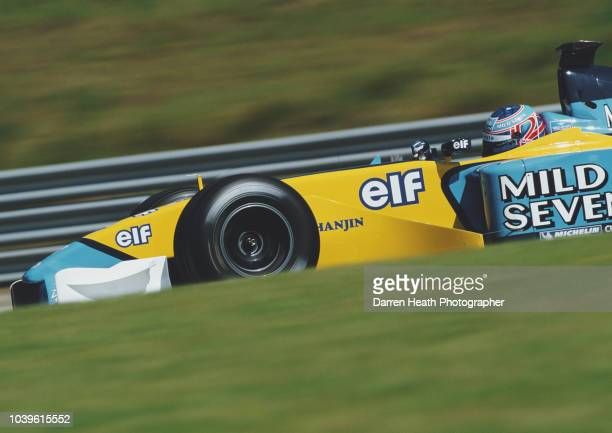 Jenson Button of Great Britain drives the Mild Seven Renault F1 Team Renault R202 Renault RS22 V10 during the Formula One Austrian Grand Prix on 12...