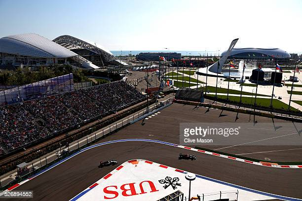 Jenson Button of Great Britain driving the McLaren Honda Formula 1 Team McLaren MP431 Honda RA616H Hybrid turbo and Sergio Perez of Mexico driving...
