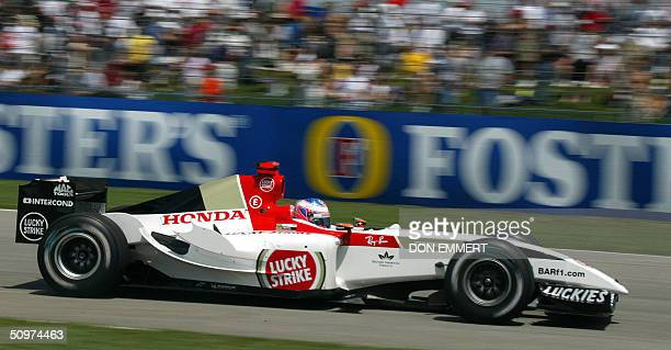 Jenson Button of Great Britain races past the crowd during practice 18 June at the US Grand Prix at the Indianapolis Motor Speedway in Indianapolis...