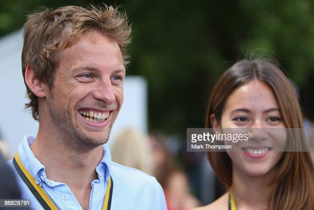 Jenson Button of Great Britain with his girlfriend Jessica Michibata during day three of The Goodwood Festival of Speed at The Goodwood Estate on...
