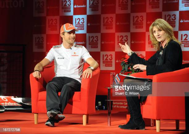 Jenson Button talks to shoppers during the Santander hosted 'An Audience with Jenson Button' event at Bluewater Shopping Centre on December 1 2012 in...