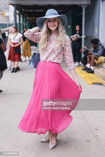 Jensyn Jeppsen is seen wearing a pink floral J Crew top, a hot pink Rachel Parcel skirt, a light blue coach bag and Valentino shoes on the street...