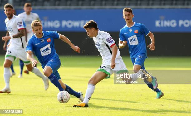 Joeri Dequevy of OH Leuven in action with Andreas Burssens of Gent during the preseason friendly match between OH Leuven and Gent at Den Dreef...