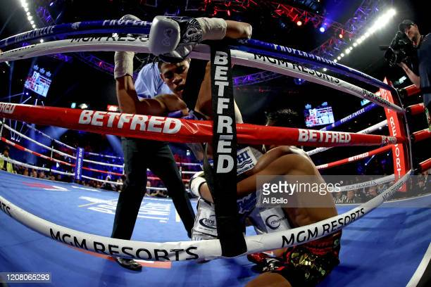 Jeo Santisima grabs Emanuel Navarrete during their bout for Navarrete's WBO junior featherweight title on February 22 2020 at MGM Grand Garden Arena...