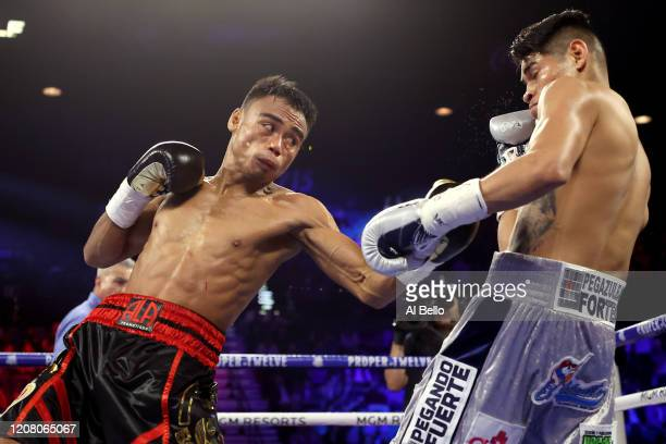 Jeo Santisima punches Emanuel Navarrete during their bout for Navarrete's WBO junior featherweight title on February 22 2020 at MGM Grand Garden...