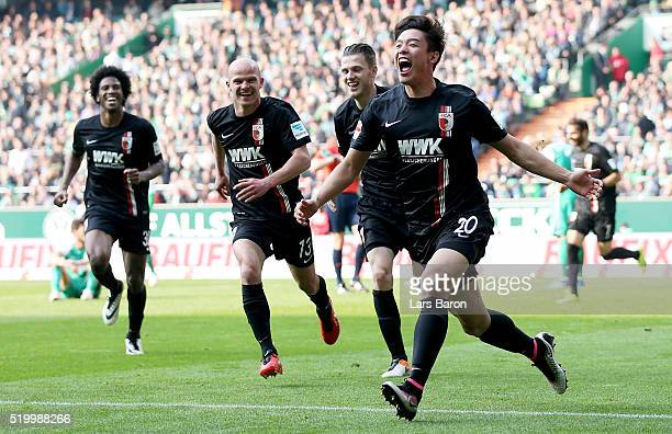 Jeon Ho Hong of Augsburg celebrates after scoring his teams winning goal during the Bundesliga match between Werder Bremen and FC Augsburg at...