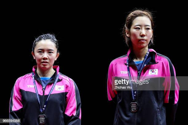 Jeon Jihee and Yang Haeun of South Korea attend the award ceremony at the women's doubles final compete with Ding Ning and Zhu Yuling of China during...