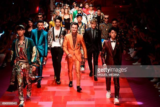 Jeon June Brandon Thomas Lee and Karry Wang JunKai present creations for fashion house Dolce Gabbana during the Men's Spring/Summer 2018 fashion...
