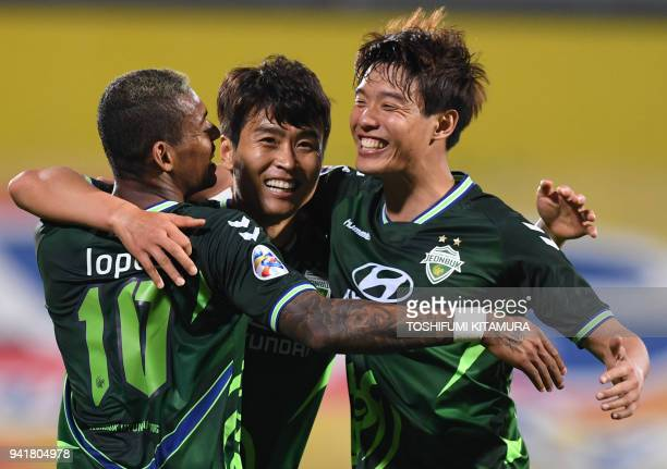 Jeonbuk forward Lee Donggook celebrates after a goal with teammates Ricardo Lopes and Hong Jeongho during the AFC Champions League Group E football...