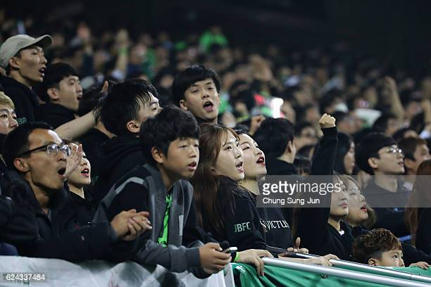 Jeonbuk Hyundai Motor supporters cheer during the AFC Champions League Final 2016 1st leg match between Jeonbuk Hyundai Motor and Al Ain at Jeonju...