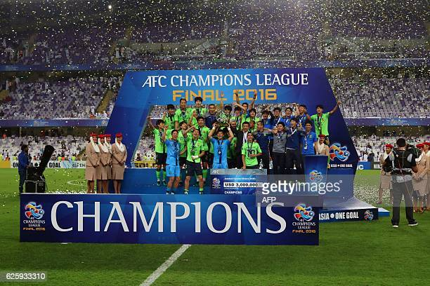 Jeonbuk players celebrate as they are crowned champions following their AFC Champions League final between UAE's AlAin and South Korea's Jeonbuk...