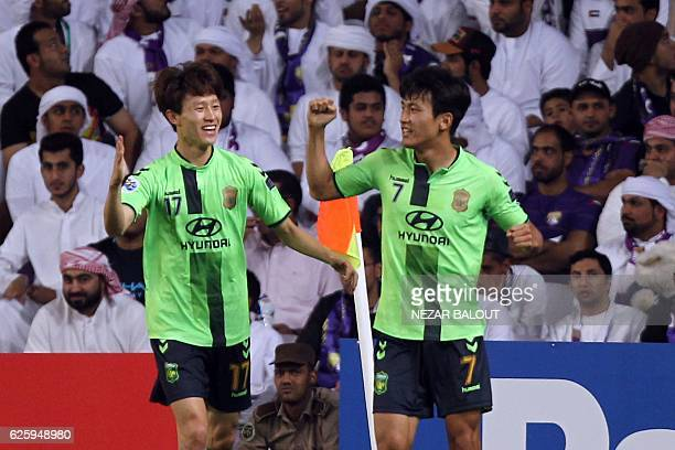 Jeonbuk's midfielder Han Kyo Won celebrates his goal with teammate Lee Jan Sung during their AFC Champions League final between UAE's AlAin and South...