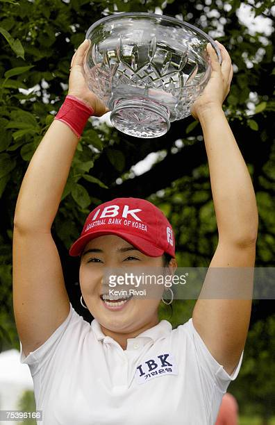 Jeong Jang raises her trophy after winning the Wegmans LPGA with a 13-under 275 at Locust Hill Country Club in Rochester, New York on Sunday, June...
